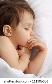 Fine little girl sleeping in bed at home