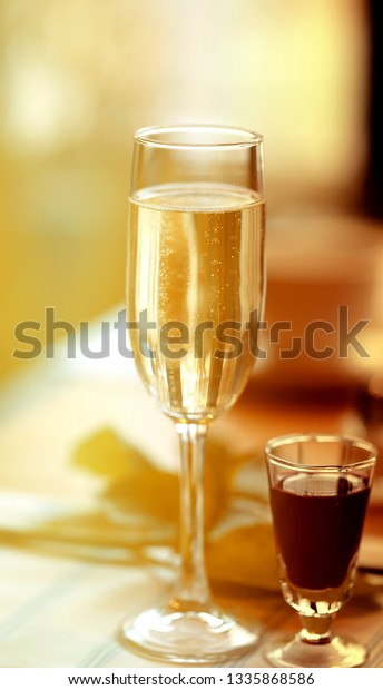 Fine macro photo of champagne glass in a restaurant for a holiday