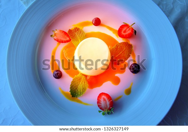 Fine macro photo of dessert cake on a plate with fruit in a restaurant
