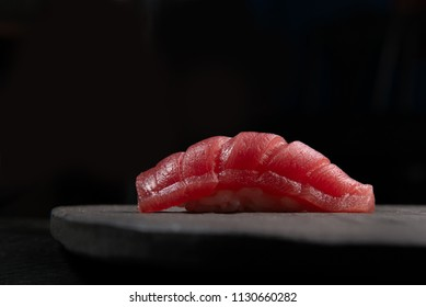 fine maguro shutoro nigiri sushi on stone with black background