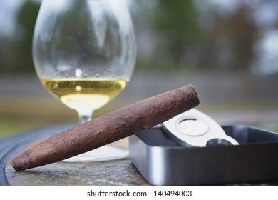 A Fine Perfecto Cigar and glass of tequila.