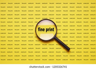 fine print enlarged with magnifying glass magnifier loupe, business concept