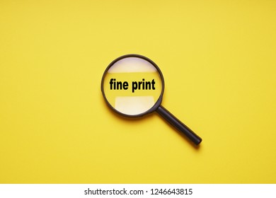 fine print enlarged with magnifying glass magnifier loupe, minimal concept on yellow background with copy space