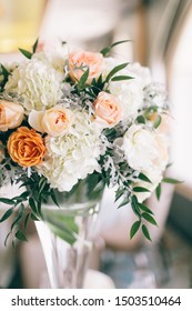 Fine wedding flower table arrangement at reception, pink, white and orange peonies, expensive wedding flowers