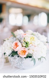 Fine wedding flower table arrangement at reception, pink, white and orange peonies, expensive wedding flowers, expensive wedding reception setting