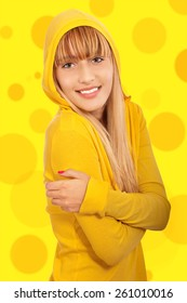 Fine young woman in yellow jacket, it is on yellow background.
