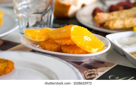 finely chopped orange slices at breakfast table