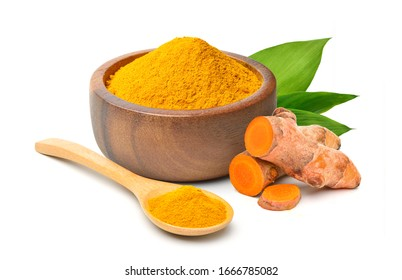 Finely dry Turmeric (Curcuma longa Linn) powder in wooden bowl with  rhizome (root) sliced and green leaves isolated on white background.