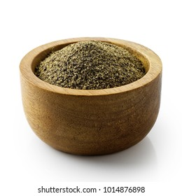 Finely ground black pepper in dark wood bowl isolated on white.