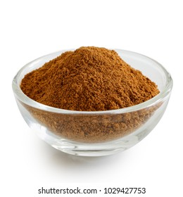 Finely ground cinnamon in glass bowl isolated on white.
