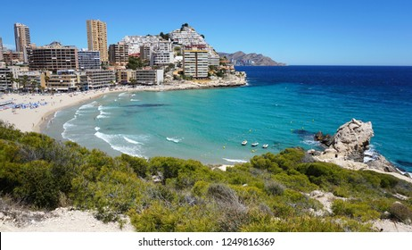 Finestrat, Benidorm/ Spain - 05/16/2018: view of sunny bright Finestrat beach and houses on Benidorm hill