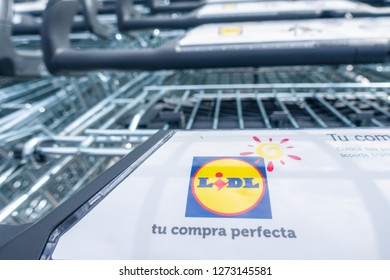 Finestrat, Spain - March 13, 2018. Logo emblem of the Lidl supermarket on shopping carts. Lidl is a german global supermarket chain