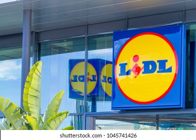 Finestrat, Spain - March 9, 2018: Lidl supermarket logo on new modern glass store facade.