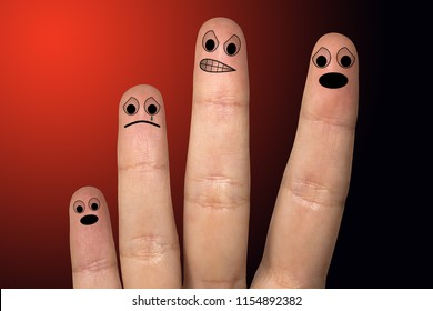 Finger art. Concept of group of people with different personalities over red background. Creative conceptual image of finger art, domestic violence.