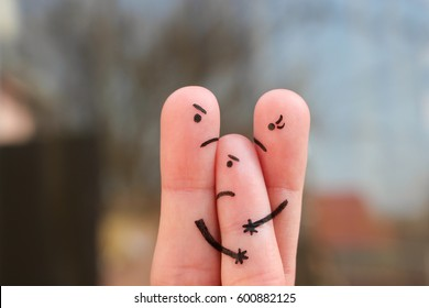 Finger art of family during quarrel. Concept of divorced parents. Idea mother does not gives child to communicate with his father.