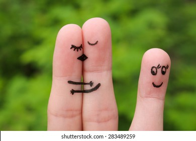 Finger art of Happy couple kissing and hugging. Other girl looks at them and rejoices.
