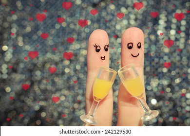 Finger art of a Happy couple. Couple making good cheer. Two glasses of champagne. Valentine's day. Toned image.