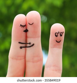 Finger art of Happy couple. Woman and man kissing and hugging. Other girl looks at them and rejoices.