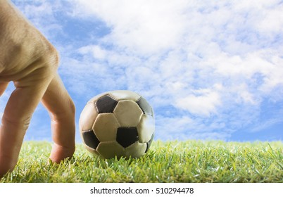 Finger with ball on white background ,Copy space , Concept for fun soccer