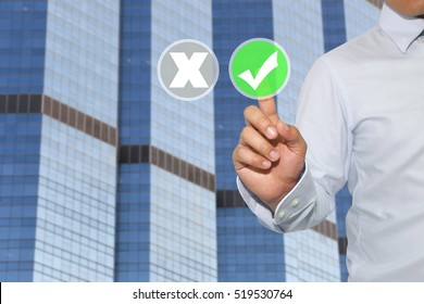 Finger of Businessman touch to green button and white check mark,Concept of decisions in business and advertising.