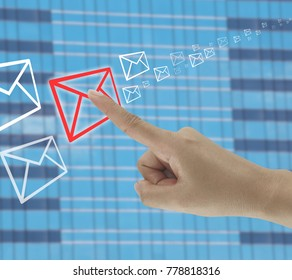 finger of businessman touches on the envelope icon in concept of business communication by email.