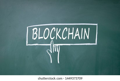 finger click blockchain symbol on blackboard