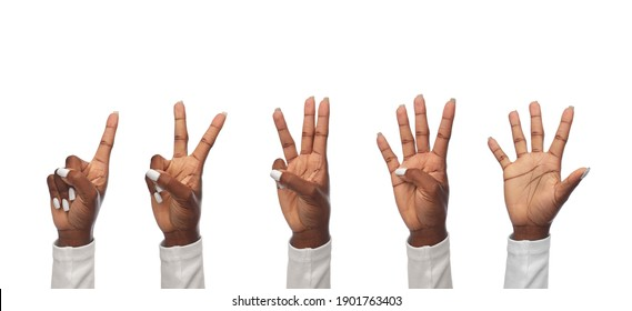finger count, gesture and people concept - hands of african american women showing fingers on white background