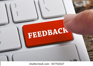 """Finger at """"FEEDBACK"""" On Keyboard Button"""