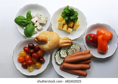 Finger food meal with cherry tomato, sausages, cheese. Patients with Alzheimer disease, not able to eat with a spoon and fork any more, can eat finger food with their hands and be more independent.