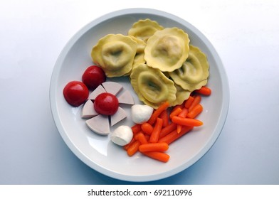 Finger foods with ravioli, salami, mozzarella, cherry tomato and baby carrots, suitable for people with Alzheimer disease, who can only eat with fingers and be more independent that way.