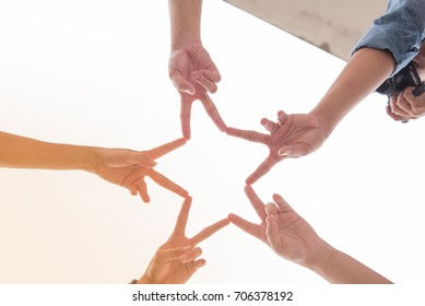 Finger in the form of a star, hand from different people, with one who take photo.