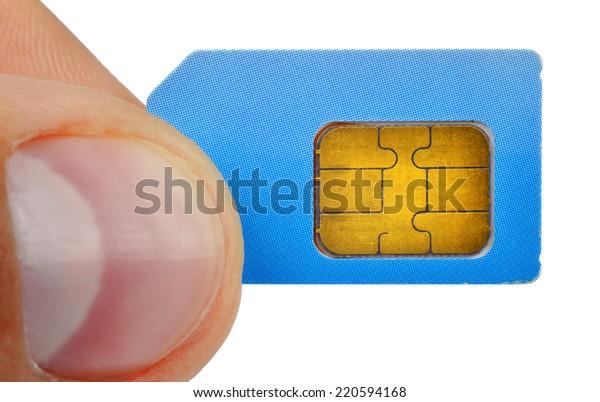 finger holding sim card isolated on white background