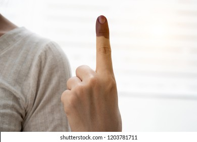 A finger mark with indelible ink at a polling station in Malaysia
