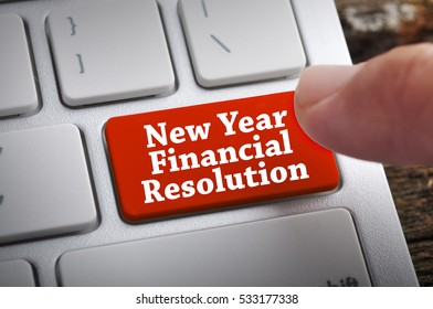 """Finger at """"New Year Financial Resolution"""" On Keyboard Button"""