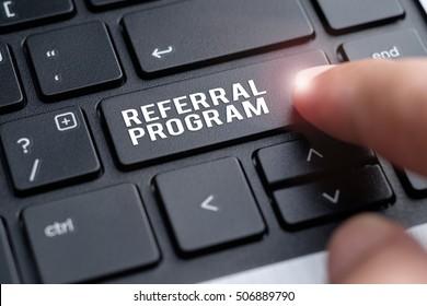 Finger on laptop keyboard written Referral Program