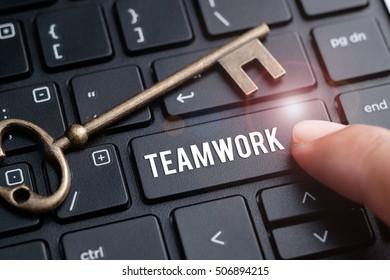 Finger on laptop keyboard written Teamwork