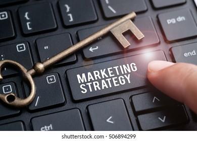 Finger on laptop keyboard written Marketing Strategy