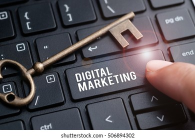Finger on laptop keyboard written Digital Marketing