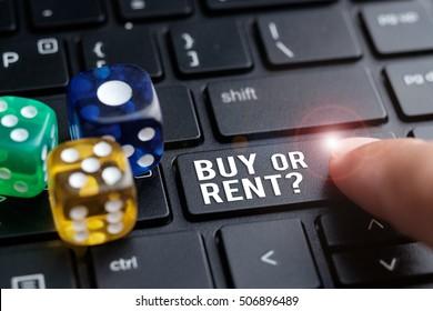 Finger on laptop keyboard written Buy or Rent? Decision making concept
