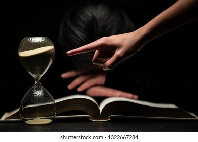 Finger of Person Pointing to Time while Woman Sleeps Over Bible