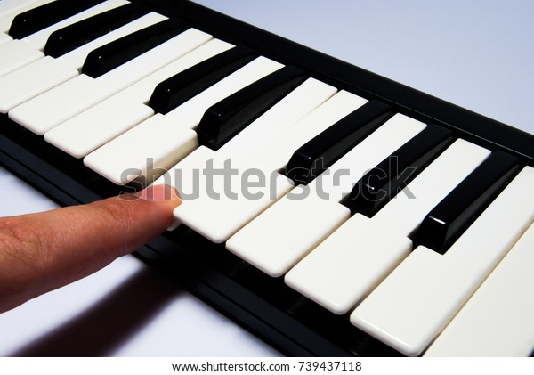 Finger Playing Note On Piano Keyboard Stock Photo (Edit Now