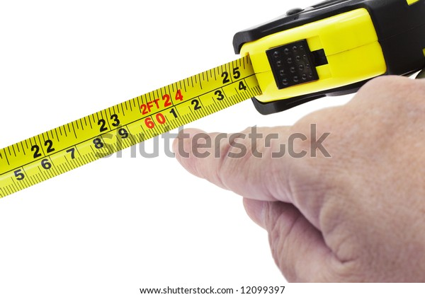 Finger pointing at 2 feet on measuring tape on white background