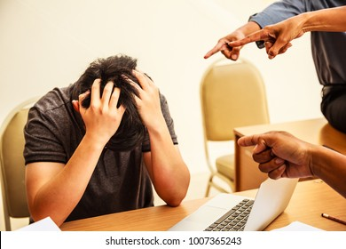 Finger Pointing, Faultfinding, Blaming. Conflict in Business Teamwork. A man looked down and guilty of accusation. Discourage, Make mistake, blunder. Wrong Corporate Culture, Misconduct, Bad Behavior.