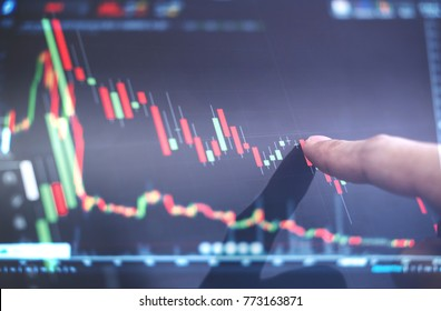 Finger pointing on stock exchange market chart