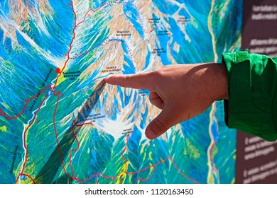 Finger pointing on a trekking map