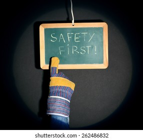 """a finger pointing plate bearing the inscription """"safety first"""""""