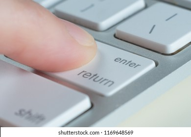 Finger is press enter key of computer keyboard.
