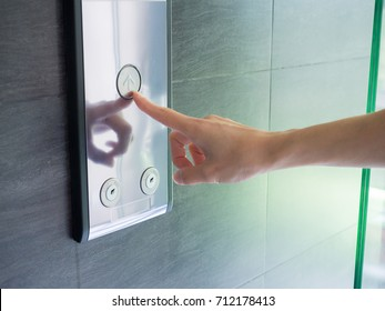 finger presses the elevator button,up and down button.woman pressing elevator button. finger presses the elevator button.