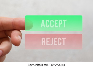Finger pressing  green accept button on virtual touchscreen on light beige background. Decision making business technology concept.