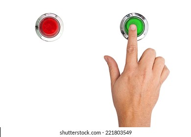 A finger pressing a green start button on white background